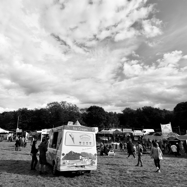 Ice cream van in a field at a festival