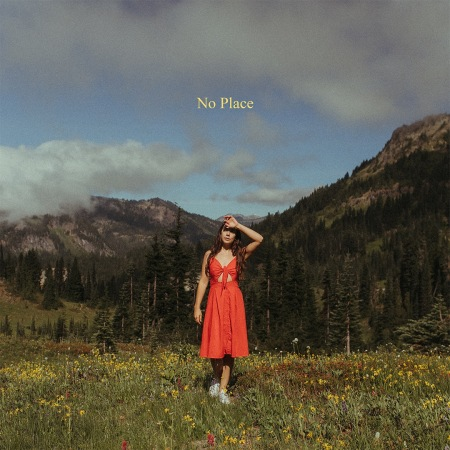 Cover for No Place, Danielle Durack wearing a red dress standing in a field